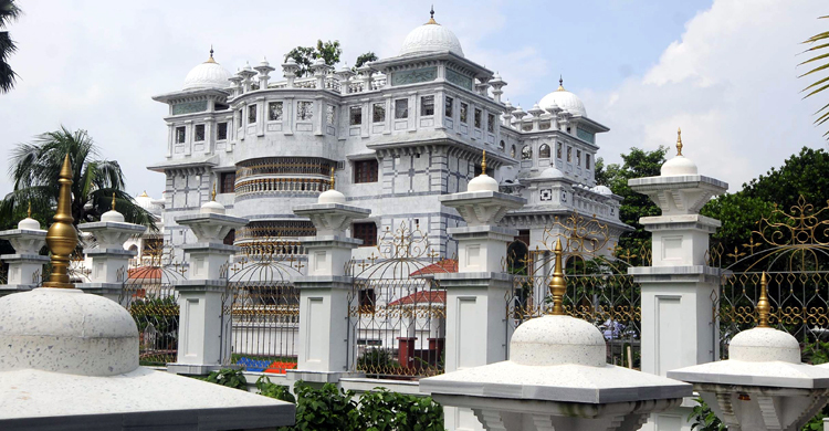 Who is the mysterious palace of a white pond in the remote village of Bogra?