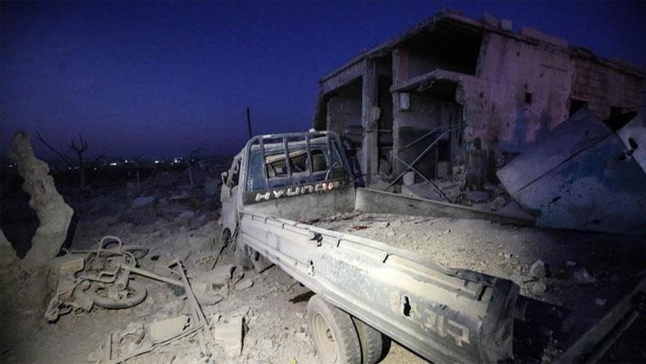 আসাদ বাহিনীর হামলায় ক্ষতিগ্রস্থ এলাকা। ছবি: আনাদলু